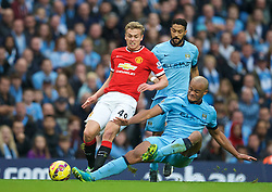 MANCHESTER, ENGLAND - Sunday, November 2, 2014: Manchester United's James Wilson is tackled by Manchester City's captain Vincent Kompany during the Premier League match at the City of Manchester Stadium. (Pic by David Rawcliffe/Propaganda)