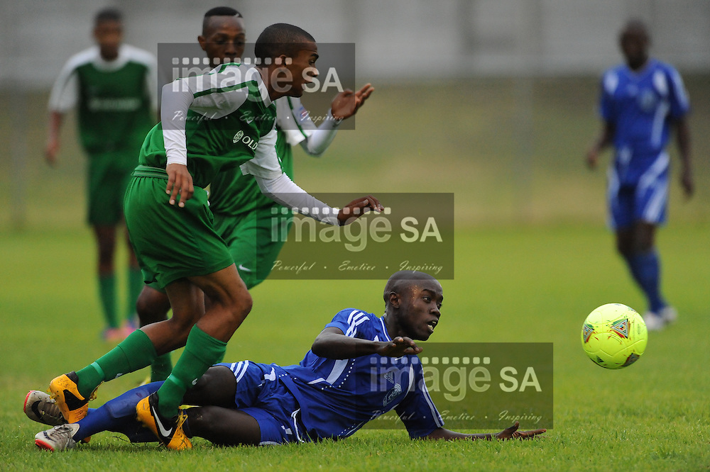 CAPE TOWN, South Africa - Thursday 28 March 2013, Moses Olawepo of Segra Academy gets tackled by Shakir Galiem of Old Mutual Academy during the match between Segra Academy (Nigeria) and Old Mutual Academy in 25th Metropolitan Premier Cup soccer tournament taking place at Erica Park Sports Complex in Belhar..Photo by Roger Sedres/ ImageSA