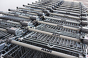 A stack of supermarket trolleys parked outside Aldi store in central Middlesborough, England, UK.