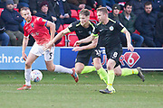Salford City defender Cameron Burgess challenged by Macclesfield Town defender Fraser Horsfall  during the EFL Sky Bet League 2 match between Salford City and Macclesfield Town at the Peninsula Stadium, Salford, United Kingdom on 23 November 2019.