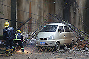 DONGGUAN, CHINA - APRIL 3: (CHINA OUT) <br /> <br /> Walls In Commercial Street Collapse<br /> <br /> The picture shows the site of collapse on April 3, 2014, in Dongguan, Guangodng Province of China. The walls in a commercial street collapse on Thursday morning which  damaged some cars near a residential building. The area of collapsed is more than one thousand cubic meters from visual inspection and no casualties reported. The reason of the collapse is still under investigation. <br /> ©Exclusivepix