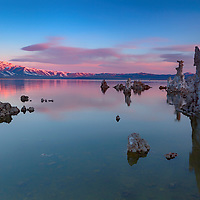 First light glows on clouds and snowy mountain tops along Mono Lake western shore. Near Lee Vining, California