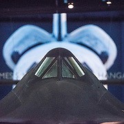 The cockpit of the Lockheed SR-71 Blackbird on display at the Smithsonian National Air and Space Museum's Udvar-Hazy Center. Located near Dulles Airport, the Udvar-Hazy Center is the second public facility of the Smithsonian's National Air and Space Museum. Housed in a large hangar are a multitude of planes, helicopter, rockets, and space vehicles. In the background are the bulging rocket thrusters of the Space Shuttle Discovery. Please note that due to the low light conditions that this was shot in, it contains some image noise when viewed at large resolutions.