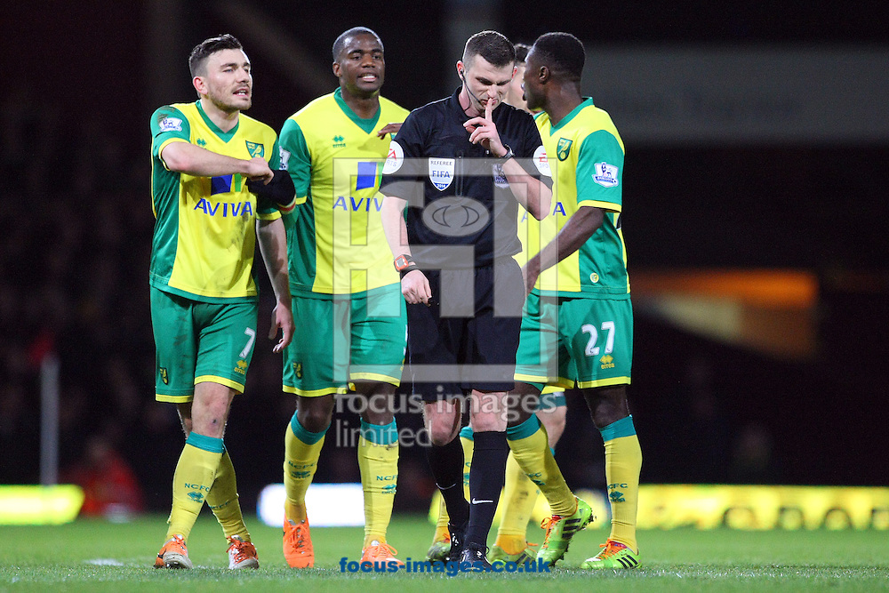 Picture by Paul Chesterton/Focus Images Ltd +44 7904 640267<br /> 11/02/2014<br /> Referee Michael Oliver tells the Norwich players to be quiet during the Barclays Premier League match at the Boleyn Ground, London