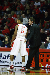 11 December 2010: Tim Jankovich gives Anthony cousin a tap on the rear during an NCAA basketball game between the Illinois - Chicago Flames (UIC) and the Illinois State Redbirds (ISU) at Redbird Arena in Normal Illinois.