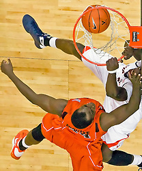Virginia center Assane Sene (5) dunks over Virginia Tech center Cheick Diakite (34).  The Virginia Cavaliers defeated the Virginia Tech Hokies 75-61 at the John Paul Jones Arena on the Grounds of the University of Virginia in Charlottesville, VA on February 18, 2009.