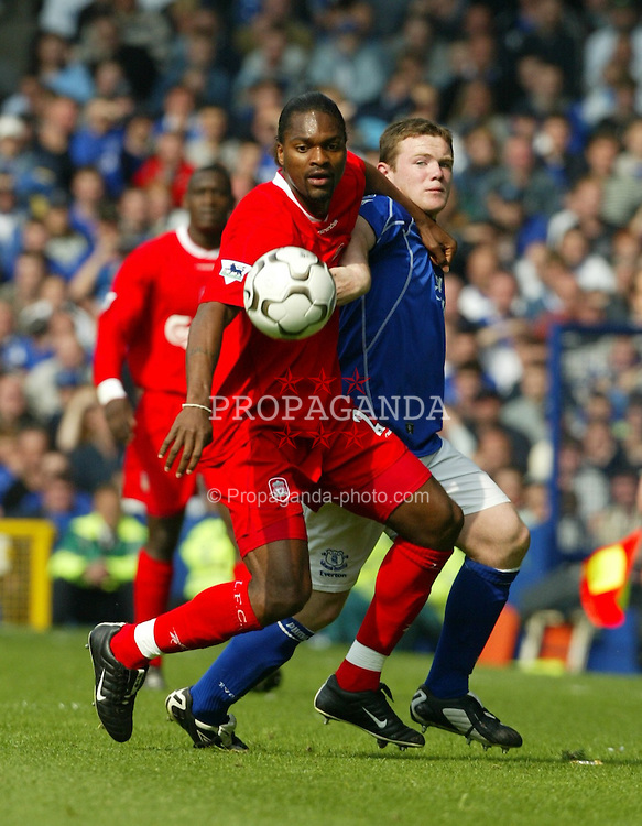 LIVERPOOL, ENGLAND - Saturday, April 19, 2003: Liverpool's Salif Diao and Everton's Wayne Rooney during the Merseyside Derby Premiership match at Goodison Park. (Pic by David Rawcliffe/Propaganda)