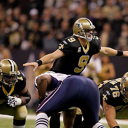2009 November 30:  New Orleans Saints quarterback Drew Brees (9) under center during a 38-17 win by the New Orleans Saints over the New England Patriots at the Louisiana Superdome in New Orleans, Louisiana.