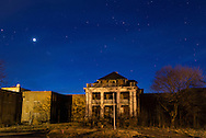 Middletown, New York - Stars and the planet Venus, at left, shine over an abandoned building at the former Middletown Psychiatric Center on April 15, 2015.