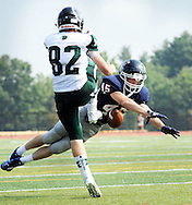 CB East's Brian Stella #45 blocks a punt by Methacton's Chris Douglas #82 which fell into the end zone for a touchdown in the first quarter Saturday September 10, 2016 at Central Bucks East High School in Buckingham, Pennsylvania. CB East defeated Methacton 42-6. (Photo by William Thomas Cain)