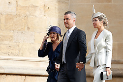 Robbie Williams arrives with his wife Ayda Field and Gwen Field to attend the wedding for the wedding of Princess Eugenie to Jack Brooksbank at St George's Chapel in Windsor Castle.