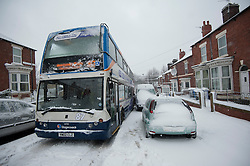 © Licensed to London News Pictures. 23/03/2013. Pitsmoor Sheffield. Nottingham Street closed after busses get stuck in heavy snow. Photo credit : David Mirzoeff/LNP