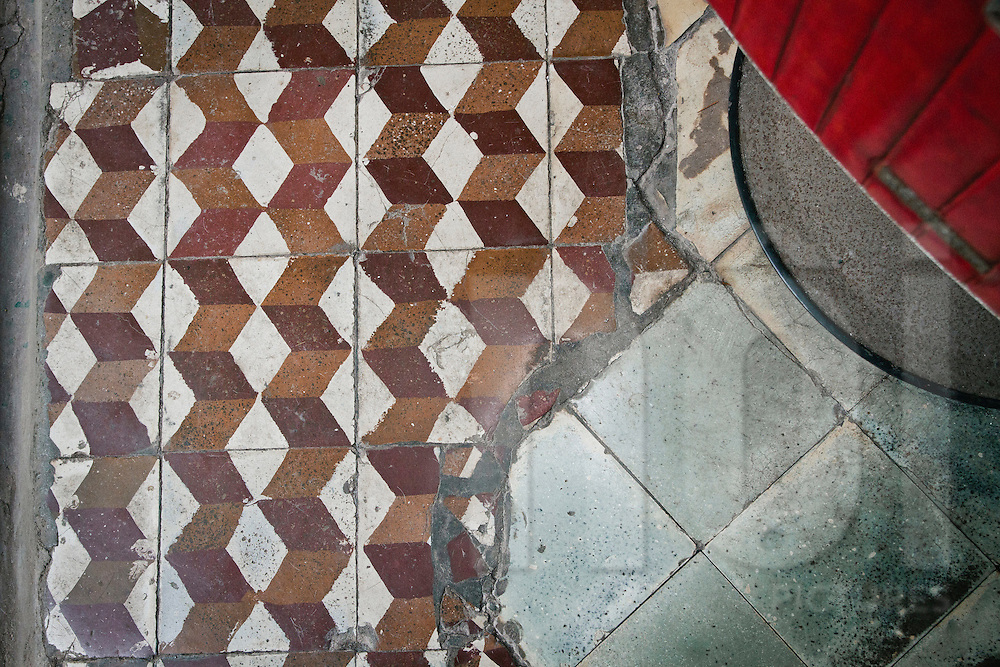 Floor tiles at an old barber shop in Hanoi, Vietnam, Asia