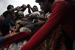 May 6, 2018 - Shopian, Kashmir, India - Kashmiri Muslims lifts the body of top Hizbul Mujahideen commander SADDAM PADDAR. Saddam was killed along with four associates including  Assistant Professor turned rebel Dr Mohammad Rafi Bhat in an encounter at Badigam village of district Shopian, Indian-administerd-Kashmir. Five civilians were also shot dead by the government forces during clashes in South Kashmir. (Credit Image: © Sanna Irshad Mattoo via ZUMA Wire)