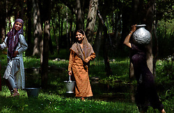 KASHMIR,INDIA: Kashmiri girls gather water from a stream in Anantnag district of Kashmir, about 60 kilometers from Srinagar, the Indian held summer capital of the state of Jammu and Kashmir.