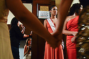 Latina beauty queens and female audience members wait in line for the restroom during intermission of the Miss Latina IL pageant at the Athenaeum Theatre, Chicago, April 21, 2012.