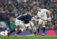 George Ford of England (R) passes past Finn Russell of Scotland (L) during the RBS 6 Nations match at Twickenham Stadium, Twickenham<br /> Picture by Andrew Tobin/Focus Images Ltd +44 7710 761829<br /> 14/03/2015