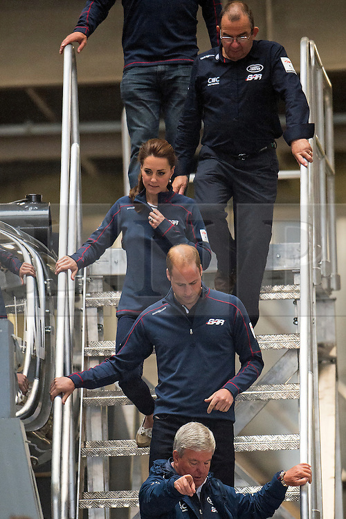 © London News Pictures. 26/07/2015. PRINCE WILLIAM, Duke of Cambridge and CATHERINE, Duchess of Cambridge during a visit to Land Rover BAR (Ben Ainslie Racing) in Portsmouth, South Hampshire, as part of a visit to the America's Cup World Series. Photo credit: Ben Cawthra/LNP