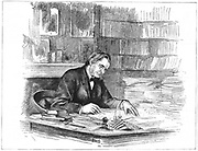 Thomas Henry Huxley (1825-1895) British biologist, at his desk in 1882 when President of the Royal Society. From 'Scientific American', New York, 1 September 1883. Engraving