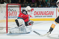 KELOWNA, CANADA - OCTOBER 25: Jackson Whistle #1 of Kelowna Rockets defends the net against the Brandon Wheat Kings on October 25, 2014 at Prospera Place in Kelowna, British Columbia, Canada.  (Photo by Marissa Baecker/Shoot the Breeze)  *** Local Caption *** Jackson Whistle;