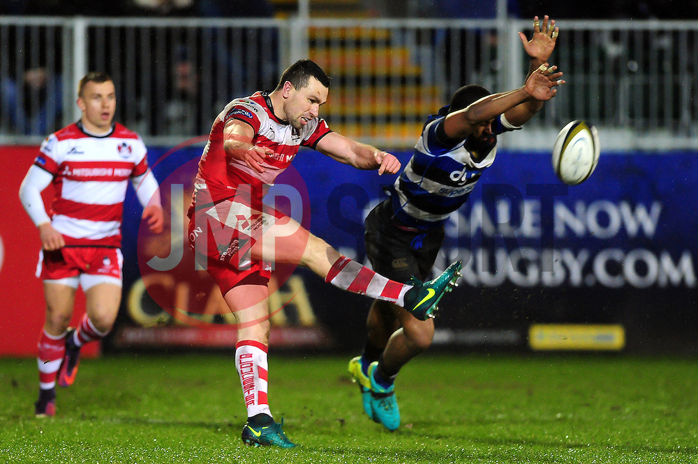 Tom Marshall of Gloucester Rugby boots the ball away as Aled Brew of Bath Rugby looks to charge him down - Mandatory byline: Patrick Khachfe/JMP - 07966 386802 - 27/01/2017 - RUGBY UNION - The Recreation Ground - Bath, England - Bath Rugby v Gloucester Rugby - Anglo-Welsh Cup.