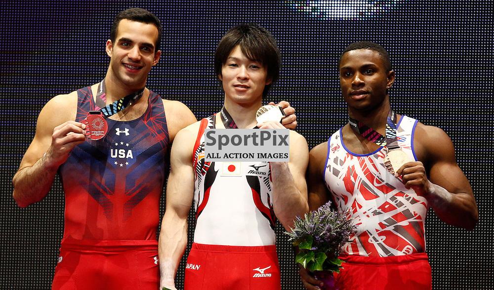 2015 Artistic Gymnastics World Championships being held in Glasgow from 23rd October to 1st November 2015.....L-R Danell Leyva (USA) Silver medal, Japan's Kohei Uchimura Gold medal & Manrique Larduet (Cuba) Bronze medal winners from the horizontal bar on Day 2 of the Women's & Men's Apparatus Final...(c) STEPHEN LAWSON | SportPix.org.uk