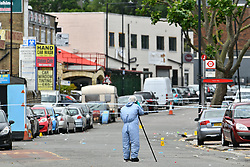 © Licensed to London News Pictures. 29/06/2017. London, UK. Police forensics at the scene where an 18 year old man was stabbed to death at a parrty in Acton West London early this morning. Photo credit: Ben Cawthra/LNP