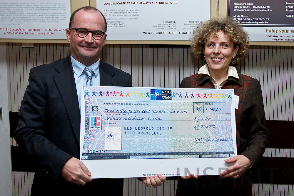 NATO Charity Bazaar raises record funds in 2011 for charities and donated €188,000 to support Belgian and international charities on 23 January, at a ceremony attended by the Deputy Secretary General Claudio Bisogniero and Mrs Anne-Mette Rasmussen Photo: Erik Luntang