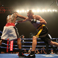 "Vitali Kopylenko (black shorts) fights Willie Monroe Jr. (white) during the ESPN ""Boxcino"" boxing tournament at Turning Stone Resort Casino on Friday, April 18, 2014 in Verona, New York.  (AP Photo/Alex Menendez)"