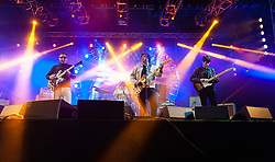 © Licensed to London News Pictures. 14/06/2015. Isle of Wight, UK.   The Lightning Seeds performing live at Isle of Wight Festival 2015, Day 4 Sunday.   In this picture - Ian Broudie (left).  Headline acts include The Prodigy, Blur and Fleetwood Mac.   Photo credit : Richard Isaac/LNP