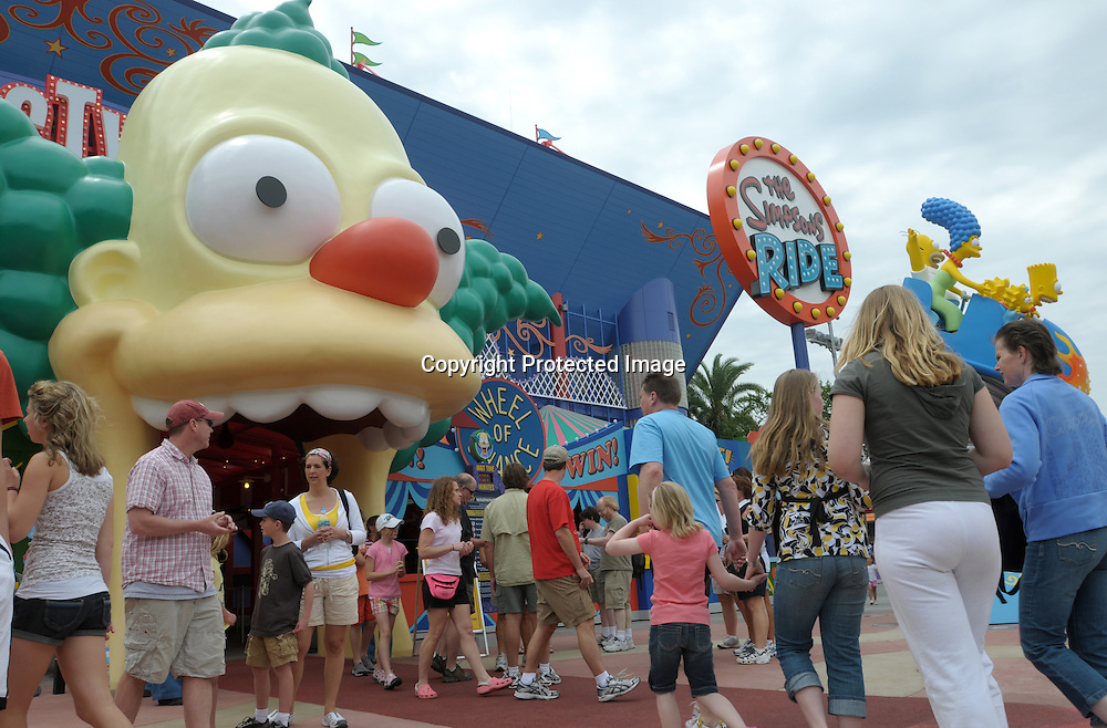 Tourists head into the newly-opened The Simpson's Ride at Universal Orlando in Orlando, Fla., Tuesday, April 29, 2008. (Photo by Phelan M. Ebenhack)