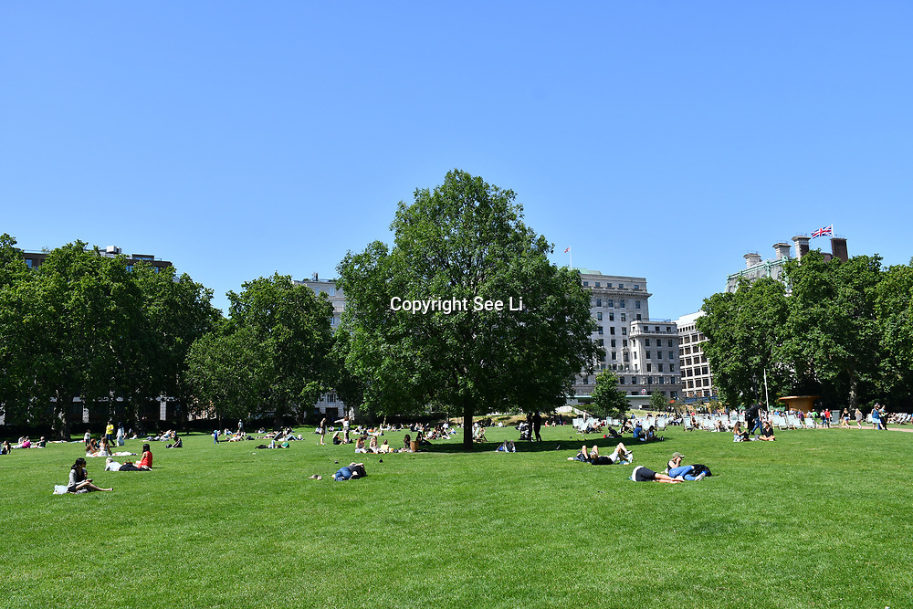 London, UK. 27 June 2019. UK Weather - People Suntan at the Hottest week in June 2019 at Green park, London, UK