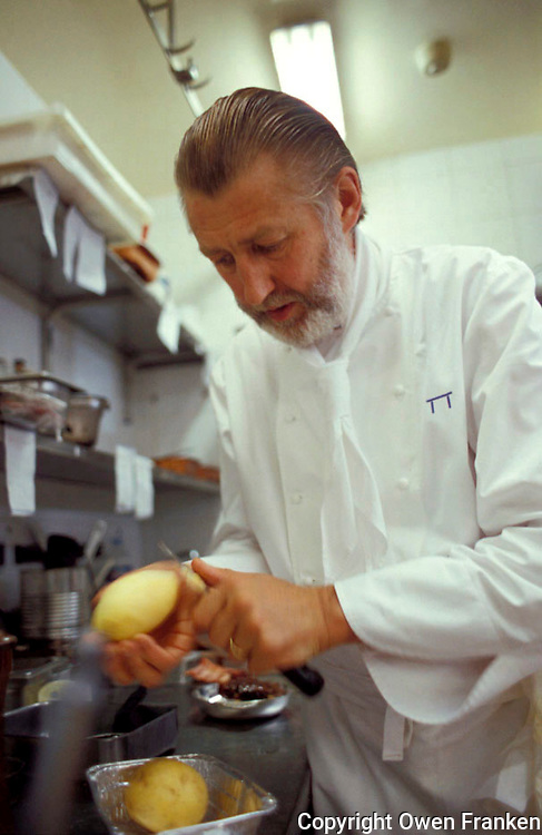 Pierre Gagnaire peeling potatoes in his Paris kitchen..© Owen Franken