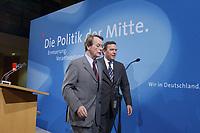 """13 MAY 2002, BERLIN/GERMANY:<br /> Franz Muentefering (L), SPD Generalsekretaer, und Gerhard Schroeder (R), SPD, Bundeskanzler, vor dem Schriftzug """"Die Politik der Mitte"""" nach der Pressekonferenz zur vorangegangenen SPD Parteikonferenz, Willi-Brandt-Haus<br /> IMAGE: 20020513-03-027<br /> KEYWORDS: Gerhard Schröder, Franz Müntefering"""
