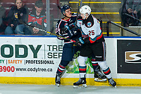 KELOWNA, BC - FEBRUARY 12: Tyson Greenway #23 of the Tri-City Americans is checked by Tyson Feist #25 of the Kelowna Rockets in third period at Prospera Place on February 8, 2020 in Kelowna, Canada. (Photo by Marissa Baecker/Shoot the Breeze)