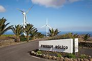Turbines and sign at Parque Eolico de Lanzarote wind farm, Lanzarote, Canary Islands, Spain