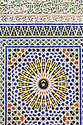 Fez, Morocco - 3rd FEBRUARY 2018 - Intricate zellige mosaic tiling work and stone carvings line a Mosque building exterior in the old Fez Medina, Middle Atlas Mountains, Morocco.