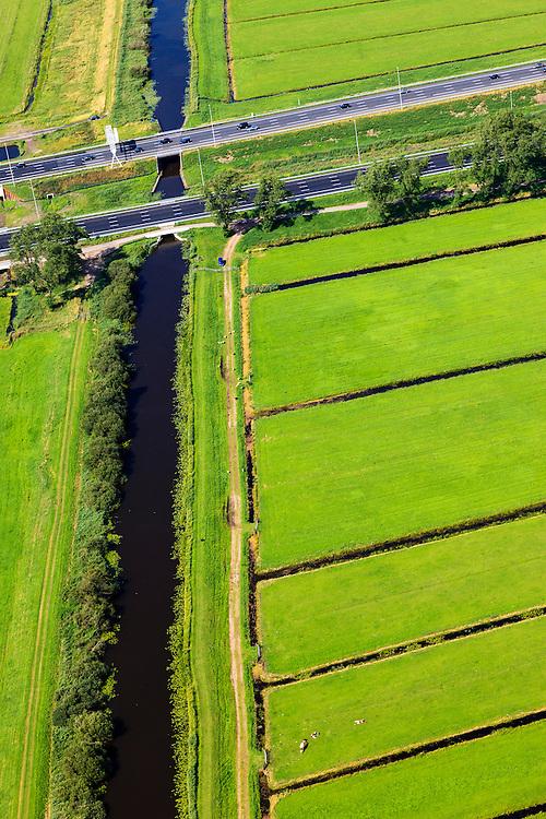 Nederland, Zuid-Holland, Gemeente Reeuwijk, 15-07-2012; autosnelweg A12 doorsnijdt het Groene Hart ter hoogte van Waarder. Het kanaal is de Enkele Wiericke, onderdeel van de Hollandse Watelinie..Highway A12 runs through the Green Heart of the Netherlands..luchtfoto (toeslag), aerial photo (additional fee required).foto/photo Siebe Swart
