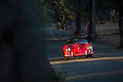 Image of a 1954 red Porsche Speedster, near Sacramento, California, west coast