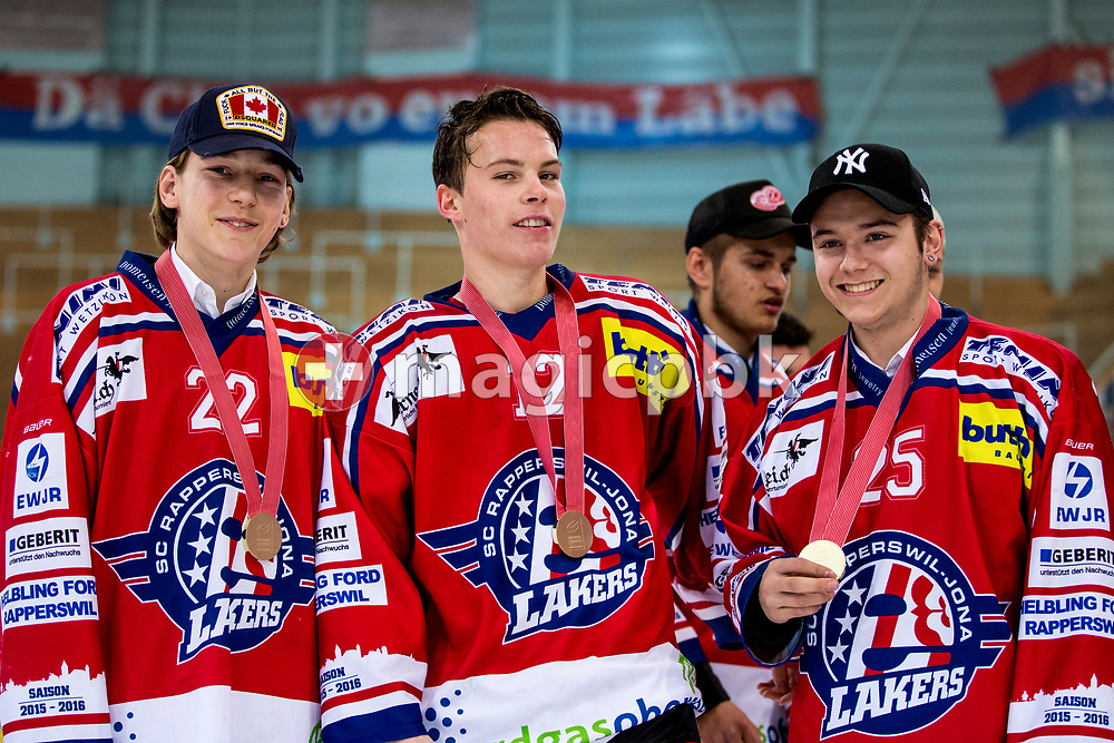 (L-R) Rapperswil-Jona Lakers forward Kim Lang, Nicola Meier and Yannik Pfister pose with their gold medals after winning the fifth Elite B Playoff Final ice hockey game between Rapperswil-Jona Lakers and ZSC Lions held at the SGKB Arena in Rapperswil, Switzerland, Sunday, Mar. 19, 2017. (Photo by Patrick B. Kraemer / MAGICPBK)