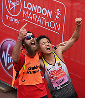 Yap Tien-Fung GER celebrates with his Guide Runner after competing in the T12 Men World Para Athletics Marathon Championships. The Virgin Money London Marathon, 28 April 2019.<br /> <br /> Photo: Joe Toth for Virgin Money London Marathon<br /> <br /> For further information: media@londonmarathonevents.co.uk