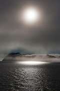 """The fogbound, Arctic island of Parryøya, or Parry Island, in the Sjuøyane archipelago, northeastern Svalbard, named after the explorer William Parry, who explored the area in 1827. Parryøya is 1000km from the North Pole, and 1600km north of the Arctic Circle.<br /> <br /> <br /> This mage can be licensed via Millennium Images. Contact me for more details, or email mail@milim.com For giclée prints, contact me, or click """"add to cart"""" to some standard print options."""