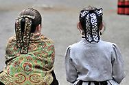 Two girls in typical costume. Pilgrimage of Nuestra Señora de Gracia in San Lorenzo de El Escorial, Madrid.