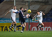 Dundee&rsquo;s Danny Williams heads clear from Ross County's James O'Brien - Ross County v Dundee in the Ladbrokes Scottish Premiership at The Global Energy Stadium, Dingwall, Photo: David Young<br /> <br />  - &copy; David Young - www.davidyoungphoto.co.uk - email: davidyoungphoto@gmail.com