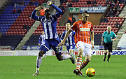 Wigan Defender Leon Barnett challenges during the Sky Bet League 1 match between Wigan Athletic and Blackpool at the DW Stadium, Wigan, England on 12 December 2015. Photo by Pete Burns.