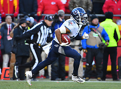 Jan 19, 2020; Kansas City, Missouri, USA;  Tennessee Titans wide receiver Kalif Raymond (14) runs the ball during the AFC Championship Game against the Kansas City Chiefs at Arrowhead Stadium. Mandatory Credit: Denny Medley-USA TODAY Sports