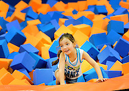LEVITTOWN, PA - AUGUST 19: Addison Martin, 5, of Holland, Pennsylvania climbs out of the Foam Pit at the grand opening of Sky Zone Indoor Trampoline Park August 19, 2014 in Levittown, Pennsylvania. A portion of the grand opening day proceeds to Alex's Lemonade Stand Foundation. (Photo by William Thomas Cain/Cain Images)