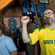 Date: 6/11/10..Fans stand as the national anthems are played at the start of the 2010 World Cup opening Group A match between South Africa and Mexico at Madiba, a South African restaurant in Fort Greene, Brooklyn on June 11, 2010.   The game finished in a 1-1 tie. ..Photo by Angela Jimenez for Newsweek .photographer contact 917-586-0916/angelajime@gmail.com