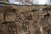 Duck hunters wait in blind for ducks to show up at private watershed lake in Shamrock, Oklahoma.