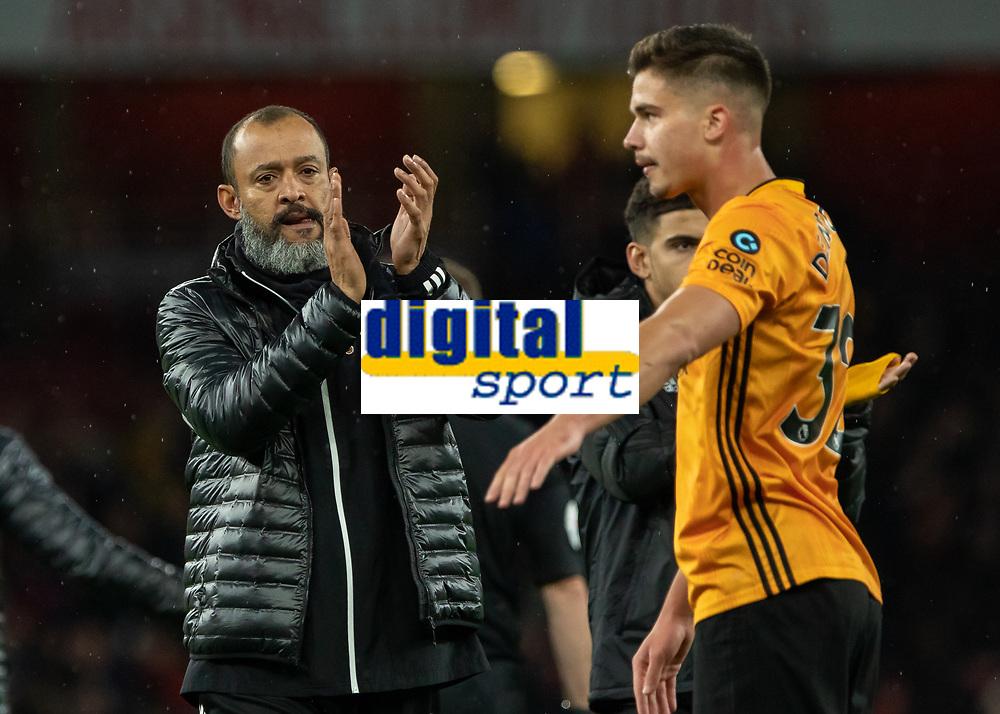 Football - 2019 / 2020 Premier League - Arsenal vs. Wolverhampton Wanderers<br /> <br /> Nuno Esoirito Santo, Manager of Wolverhampton Wanderers,  applauds the travelling fans at The Emirates Stadium.<br /> <br /> COLORSPORT/DANIEL BEARHAM